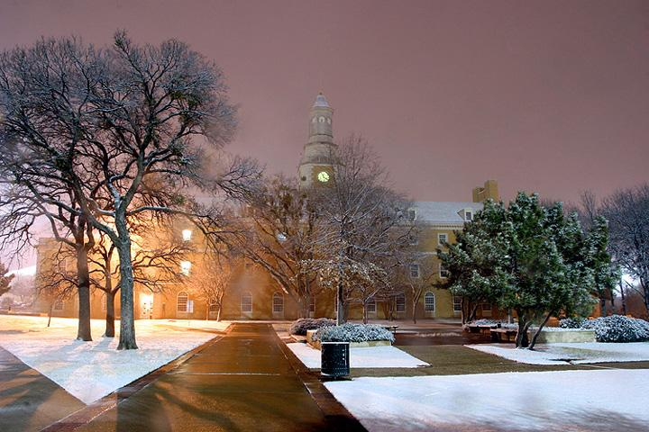 Administration building at night with snow