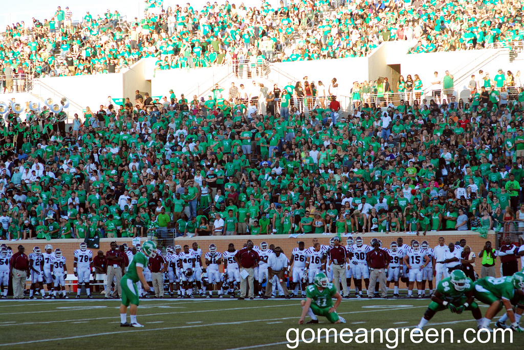 Lining up for the kick in a sea of Green