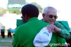 Dr. Lane Rawlins gives Mean Joe Greene a big hug