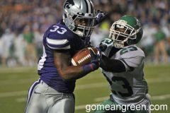 #23 Zach Whitfield brings down K-State's John Hubert