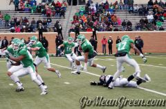 UNT's Brelan Chancellor leaps over UTSA player