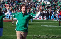 UNT students rush the Cotton Bowl field