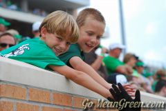 Young UNT fans high five