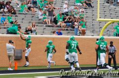Dajon celebrates with Mean Green Fan after TD