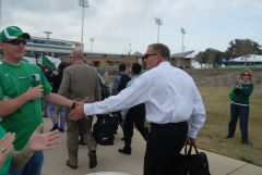 UNT Coach Dan McCarney shaking hands with fans