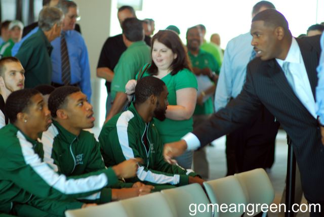 Coach Benford shakes UNT players hands