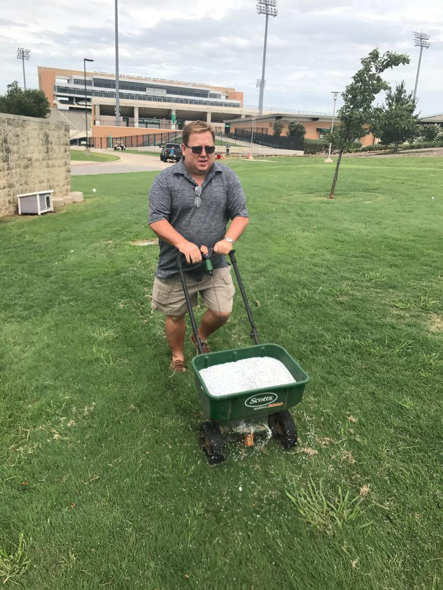 tony fertilizing and de-anting the tailgate area prior to the 2017 season